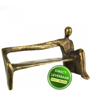 Een arm vrij bronzen beeld